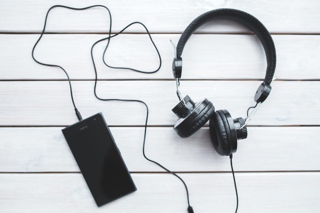 Phone and headphones image via Pexels